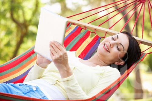bigstock Woman Relaxing In Hammock With 39679675 compressed e1447157038903